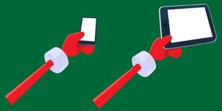 Le mani di Santa che tengono il pc della compressa e dello smartphone Immagine Stock