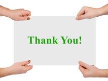 Le mani e l'insegna di carta vi ringraziano Fotografia Stock