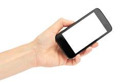 Le mani femminili tengono un telefono cellulare, modello del modello Isolato su priorità bassa bianca Immagini Stock Libere da Diritti