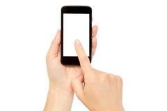 Le mani femminili tengono un telefono cellulare, modello del modello Isolato su priorità bassa bianca Fotografia Stock