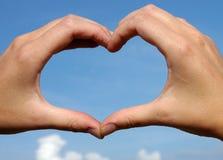 Le mani gradicono il cuore Fotografie Stock