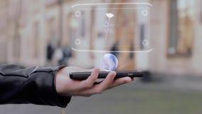 Le mani maschii mostrano sullo smartphone che l'ologramma concettuale di HUD è aumentato fiore stock footage