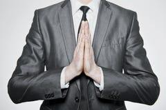 Le mani messe dentro pregano Fotografie Stock Libere da Diritti