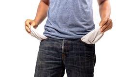 Le mani nella tasca di pantaloni senza soldi immagini stock