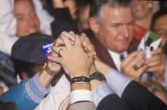 Le mani si uniscono per il regolatore Bill Clinton Fotografia Stock