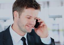 Le mannen som använder en kontorstelefon Royaltyfria Bilder