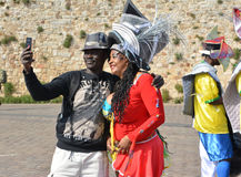 LE MANS, FRANCE - APRIL 22, 2017: man making selfie with woman in Caribbean costumes Royalty Free Stock Photography