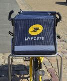 LE MANS, FRANCE - AUGUST 31, 2017: Yellow bicycle of a post office La Poste of French city stock images