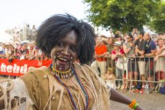 LE MANS, FRANCE - JUNE 16, 2017: African woman in national clothes dancing at the opening parade of 24 hours of Le mans Stock Image