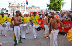 LE MANS, FRANCE - JUNE 13, 2014: Brazilian man dancing at a parade of pilots racing. Royalty Free Stock Image