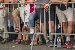 LE MANS, FRANCE - JUNE 16, 2017: A crowd of people and children behind the barrier at a Parade of pilots stock photo