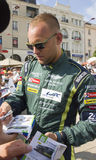 LE MANS, FRANCE-JUNE 11, 2017: Danish race car driver Marco Sorensen Aston Martin Racing gives autograph Weighing administrative a Stock Photo