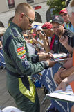 LE MANS, FRANCE-JUNE 11, 2017: Danish race car driver Marco Sorensen Aston Martin Racing gives autograph Weighing administrative a Royalty Free Stock Photography