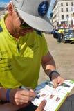LE MANS, FRANCE - JUNE 11, 2017: Famous Danish racer Nicki Thiim gives the autograph on his photo Stock Photos