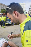 LE MANS, FRANCE - JUNE 11, 2017: Famous English racer Darren Turner gives autograph on his photo for fans. Weighing, administrativ Royalty Free Stock Photo
