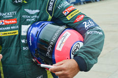 LE MANS, FRANCE - JUNE 11, 2017: Helmet and uniform of racer pilot Aston Martin racing for competition 24 hours of Le mans. Circuit stock photos