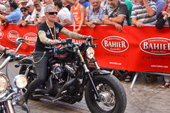 LE MANS, FRANCE - JUNE 13, 2014:Parade of pilots racing. Old women on motorcycle Stock Image