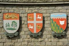 Le manteau des bras pour les provinces du prince Edward Island, Terre-Neuve et les Territoires du nord-ouest, Canada. photo stock