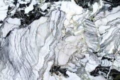Le marbre donne au blac et au blanc une consistance rugueuse Photo libre de droits