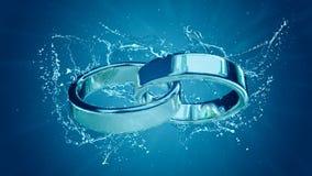 Le mariage de mariage marient l'anneau de mariage d'anneaux d'anneau sous l'éclaboussure de l'eau Image stock