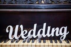 Le mariage de mot sur le piano Photo stock