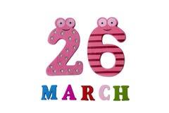 Le 26 mars, sur un fond blanc, des nombres et des lettres Photographie stock