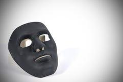 Le maschere in bianco e nero gradiscono il comportamento umano, concezione Fotografia Stock