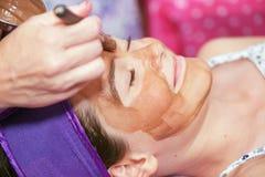 Le massage facial de l'enfant Photos libres de droits