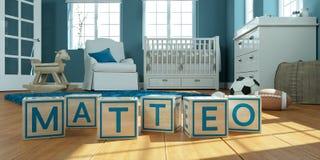 Le matteo de nom écrit avec les cubes en bois en jouet chez la pièce du ` s des enfants Images stock