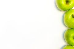 Le mele succose, delizia, mature si inverdiscono su un fondo bianco Immagine Stock