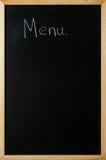 Le menu est écrit sur un tableau noir Photo stock
