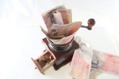 Le meulage martèle dans des penny Photos libres de droits