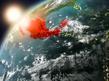 Le Mexique sur terre de planète dans le coucher du soleil Image libre de droits