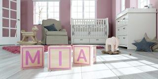 Le mia de nom écrit avec les cubes en bois en jouet chez la pièce du ` s des enfants Images stock