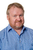 Le milieu amical a vieilli le type barbu dans la chemise bleue - sur le blanc Image stock