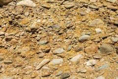 Le minerai orange de saleté de pavé rond souille le fond Photos stock