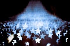 Le modèle abstrait de fusée de bokeh et de lentille en étoile forment avec le filtre de vintage Image libre de droits