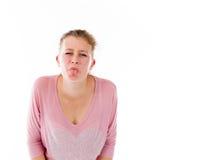 Le modèle d'isolement sur le visage simple de fond semble en difficulté Photographie stock libre de droits