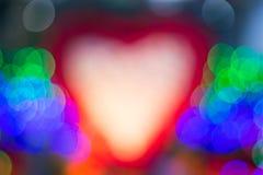 Le modèle de coeur avec la photo légère de tache floue de bokeh Photo libre de droits