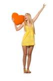 Le modèle juste caucasien dans la robe jaune d'été d'isolement sur le blanc Images stock