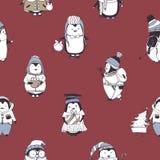 Le modèle sans couture avec les pingouins drôles de bébé portant le divers hiver vêtx sur le fond rouge Contexte avec la bande de Image libre de droits