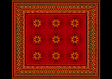 Le modèle sensible du tapis aux nuances rouges avec les détails oranges Image stock