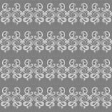 Le modèle sur un fond gris Image stock