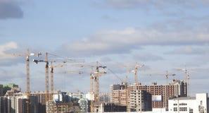 Le molte gru di costruzione Fotografie Stock Libere da Diritti