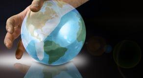 Le monde à vos doigts Photographie stock libre de droits