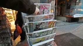 Le Monde newspapers about Donald Trump new USA president. PARIS, FRANCE - NOV 10, 2016: Man buying Le Monde newspaper with shocking headline title at press kiosk stock video