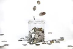 Le monete di caduta Fotografie Stock Libere da Diritti