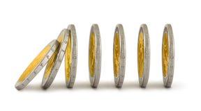 Le monete di caduta gradicono un domino Fotografia Stock