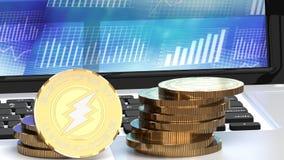 Le monete di Eletroneum si chiudono su su un computer portatile, grafici nei precedenti Fotografia Stock