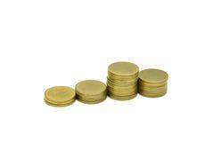 Le monete di oro hanno isolato Immagini Stock
